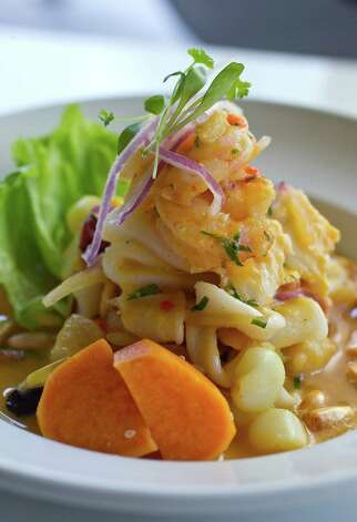 "The Cebiche Pescador (mixed seafood ""fisherman"" ceviche with sweet potato and peruvian corn) at Latin Bites at 5709 Woodway near Chimney Rock on Tuesday, Feb. 7, 2012, in Houston. Latin Bites, the much acclaimed Peruvian cafe that earned great foodie allegiance over the past couple of years, got too small for its wee space in downtown Houston. Two weeks ago, the restaurant made a leap to a bigger store and quite far from its original stomping grounds. Latin Bites occupies the former home of Rockwood Room.  ( Karen Warren / Houston Chronicle ) Photo: Karen Warren, Staff / 2012  Houston Chronicle"