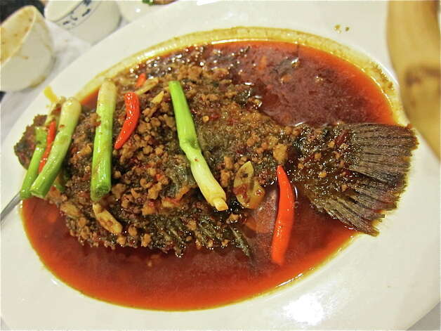 Chengdu-style Pot Roasted Tilapia, live from the tank, at Mala Sichuan. Photo by Alison Cook Photo: Alison Cook