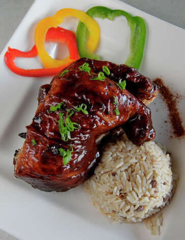 The jerk chicken, which is the signature dish at Jamaica House, is seen on Thursday, Sept. 23, 2010, in Houston. ( Julio Cortez / Houston Chronicle ) Photo: Julio Cortez, Staff / Houston Chronicle