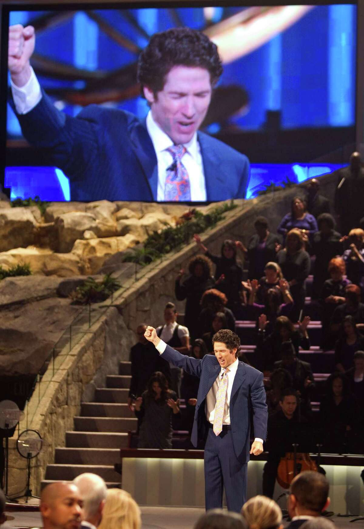 Lakewood Church Pastor Joel Osteen, gives his sermon to his 11 a.m. sermon, Sunday, Aug. 28, 2011, in Houston. Olsteen's church averages about 40,000 people in attendance per week. ( Nick de la Torre / Houston Chronicle )