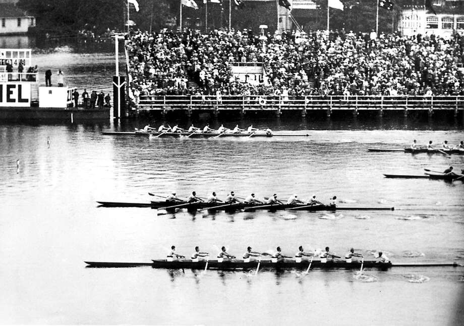 The University of Washington crew (top) won gold at the 1936 Olympics in Berlin, beating Italy and Germany with a frustrated Adolf Hitler watching. In 1999, it was selected by the Seattle Post-Intelligencer as the defining Seattle sports moment of the century. Photo: UW Photo/seattlepi.com File