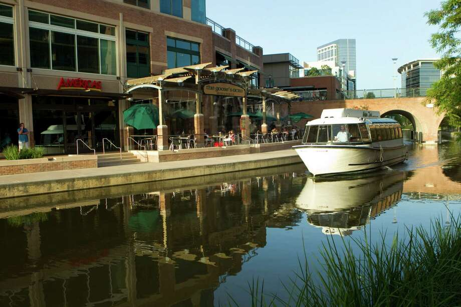 The Woodlands master-planned community has has expanded its shopping and recreational offerings over the years. Here, a water taxi awaits passengers along the waterway that winds through the shopping and entertainment part of the area. Photo: Brett Coomer, HC Staff / Houston Chronicle