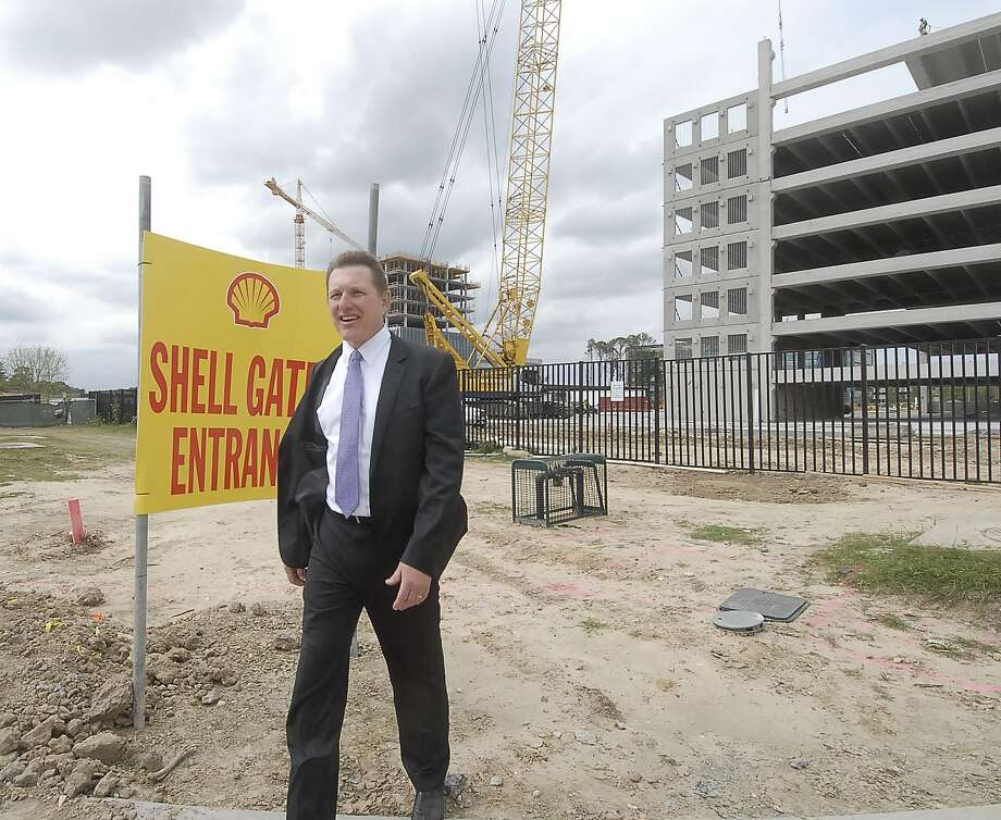 More than 70,000 workers file in to the Energy Corridor, one of several business and shopping centers in the Memorial area. Here, Energy Corridor District general manager Clark Martinson walks through the the construction site for Shell on Dairy Ashford and the Katy Freeway. Photo: Â Tony Bullard 2013, Freelance Photographer / © Tony Bullard & the Houston Chronicle