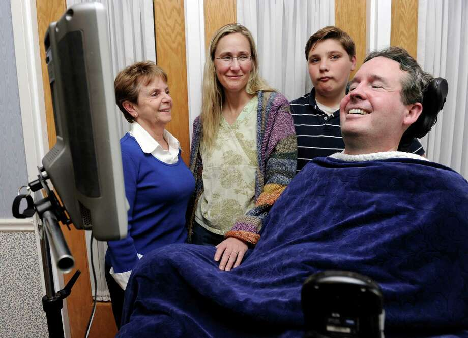 From left, Shirley Fredlund of Voice for Joanie, Scarlett Lewis and J.T. Lewis, 12, mother and brother of Sandy Hook shooting victim Jesse Lewis, visit with Bobby Murray, who suffers from Lou Gehrig's disease and is seen here with the eye-activated communication device that he uses, Wednesday, May 1, 2013. Photo: Carol Kaliff / The News-Times