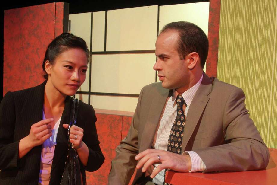 "Xi (Vivian Chiu) and Daniel (Mike Yager) make a connection in Black Lab Theatre and Asia Society's ""Chinglish."" Photo: Gary Fountain, Freelance / Copyright 2013 Gary Fountain"