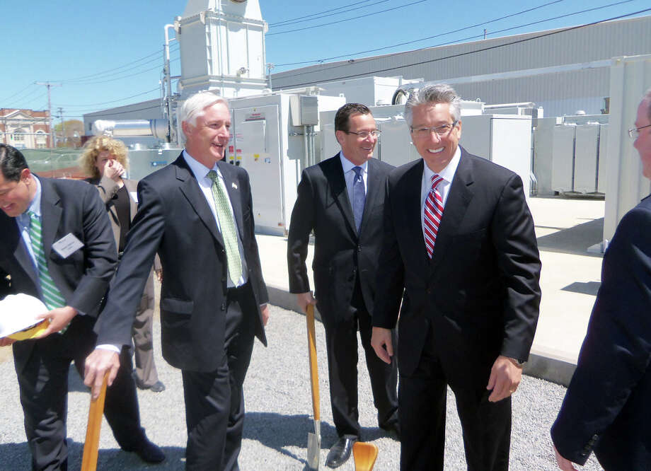 Bridgeport Mayor Bill Finch, left; Conn. Gov. Dannel Malloy, center; and Chip Bottone, president and CEO of FuelCell Energy of Danbury at the dedication of  the largest fuel cell power plant in North America, on the Bridgeport's West End. It was dedicated on Friday, May 3, 2013. The 14.9 megawatt plant will go on-line by Jan. 1, officials said. Photo: John Burgeson / Connecticut Post