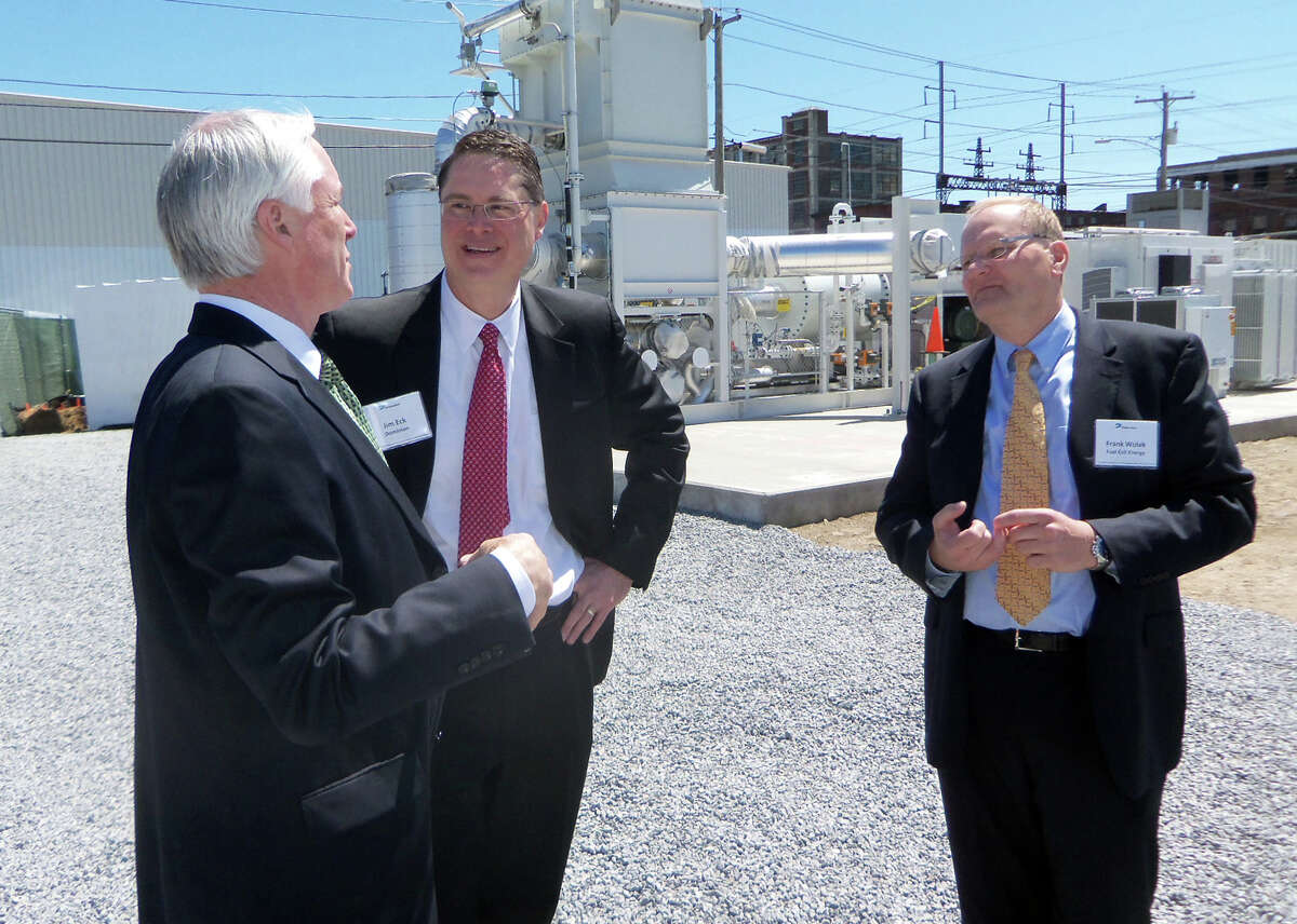 Bridgeport Mayor Bill Finch chats with Jim Eck, Dominion Resources vice-president of business development, and Frank Wolak, vice president of FuelCell Energy on May 3, 2013 in Bridgeport, Conn. The two companies were behind the creation of the largest fuel cell power plant in North America, on the city's West End. The 14 megawatt plant will go on-line by Jan. 1, officials said.