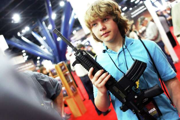 James Beaver, 13, of Denison holds a HK 416 D while learning about the NRA's Whittington Center Outdoor Adventure