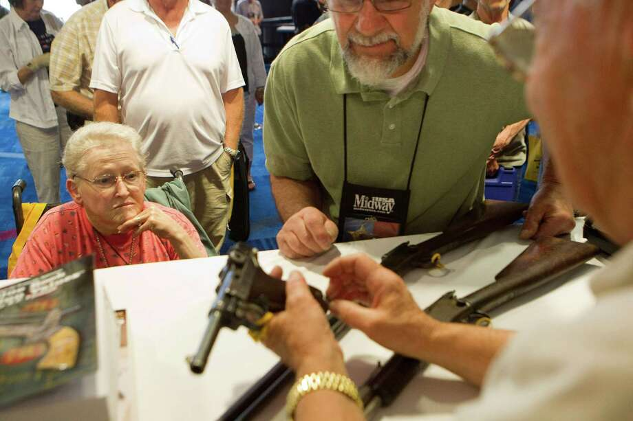 NRA attendee Janet Bero and her husband, David, of Newark, Ohio, has their German Luger appraised during the NRA's Antiques Guns and Gold Showcase during the National Rifle Association's 142 Annual Meetings and Exhibits at the George R. Brown Convention Center Thursday, May 2, 2013, in Houston.  NRA's Antiques Guns and Gold Showcase is a television show that runs on the Sportsman Channel. The 2013 NRA Annual Meetings and Exhibits runs from Friday, May 3, through Sunday, May 5.  More than 70,000 are expected to attend the event with more than 500 exhibitors represented. The convention will features training and education demos, the Antiques Guns and Gold Showcase, book signings, speakers including Glenn Beck, Ted Nugent and Sarah Palin as well as NRA Youth Day on Sunday Photo: Johnny Hanson, Houston Chronicle / © 2013  Houston Chronicle