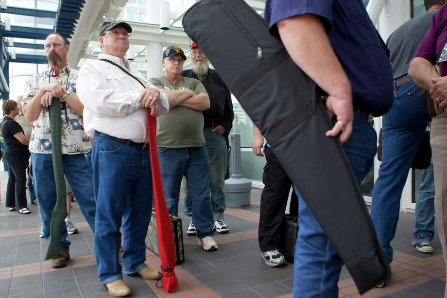 NRA attendees wait outside of the George R. Brown Convention Center to have their guns appraised at the NRA's Antiques Guns and Gold Showcase during the National Rifle Association's 142 Annual Meetings and Exhibits at the George R. Brown Convention Center Thursday, May 2, 2013, in Houston. 