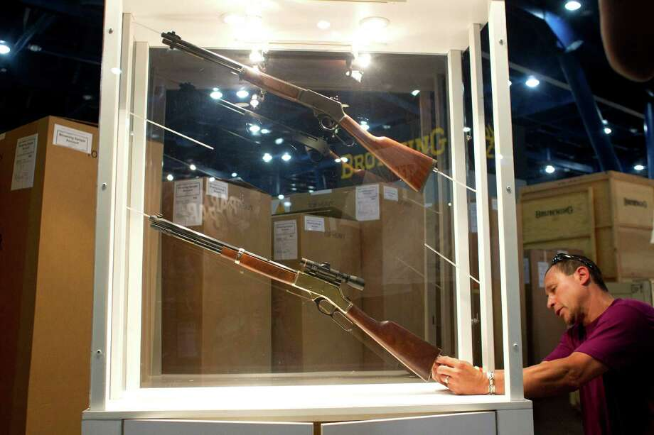 Johnny Bass sets up the Henry Repeating Arms Company booth as exhibitors began setting up their exhibits in preparation for the National Rifle Association's 142 Annual Meetings and Exhibits at the George R. Brown Convention Center Wednesday, May 1, 2013, in Houston. 