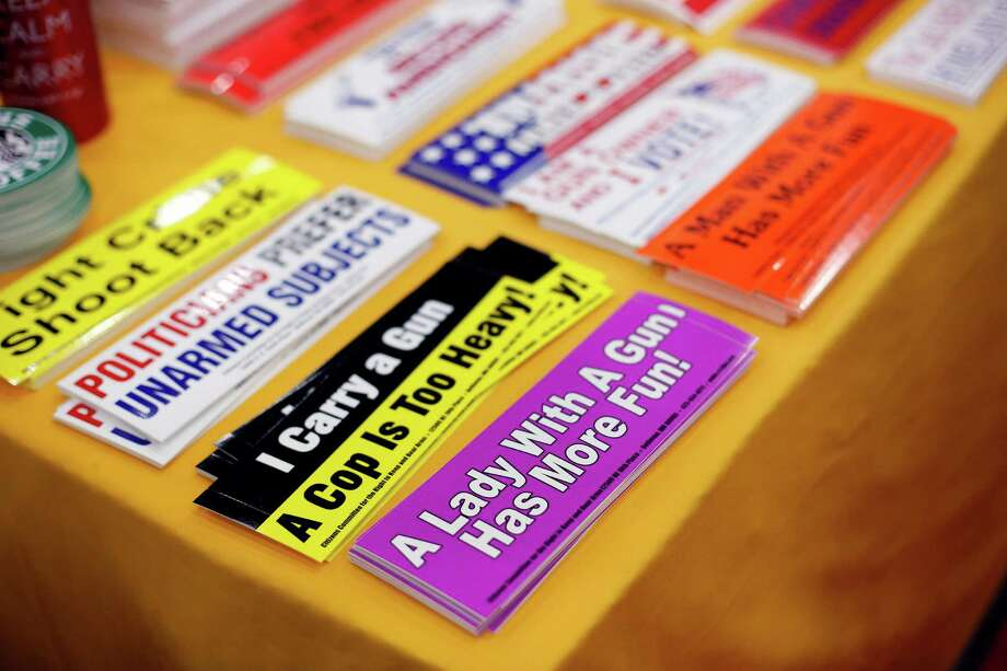 A display of humorous bumper stickers is seen, during day 1 of the 142nd NRA annual meetings and exhibits, Friday, May 3, 2013 at the George R Brown convention center in  (TODD SPOTH FOR THE CHRONICLE) Photo: © TODD SPOTH, 2013 / © TODD SPOTH, 2013