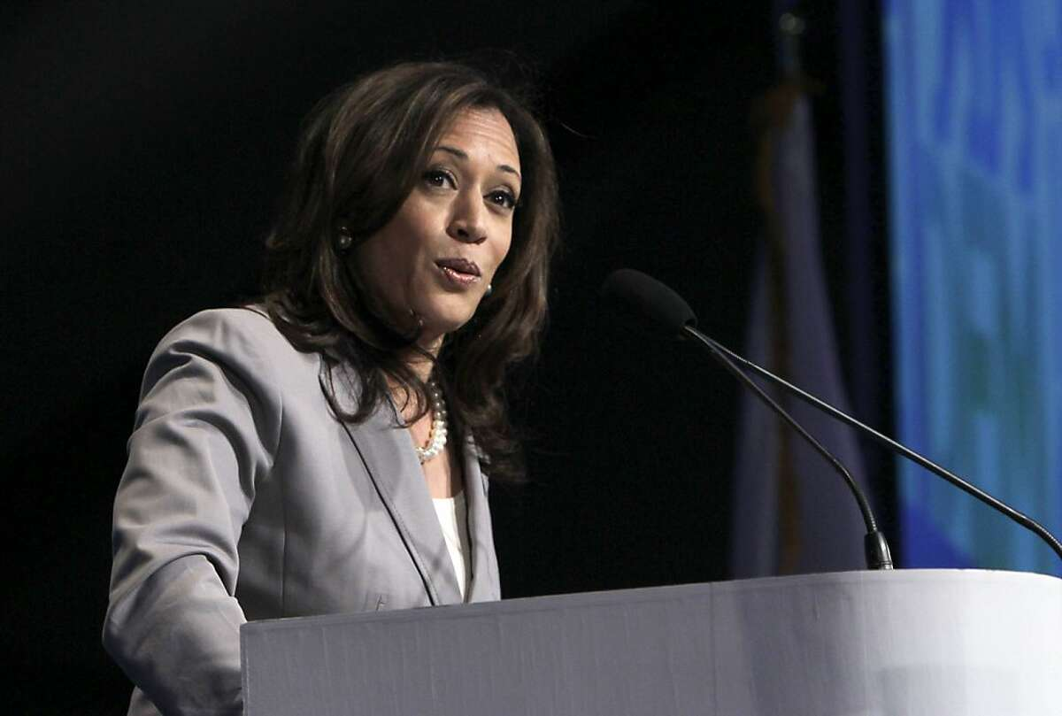 FILE - This April 13, 2013 file photo shows Attorney General Kamala Harris speaking before delegates to the 2013 Democratic Party state convention in Sacramento, Calif. President Barack Obama introduced California's Kamala Harris at a Democratic fundraiser as brilliant, dedicated, tough and