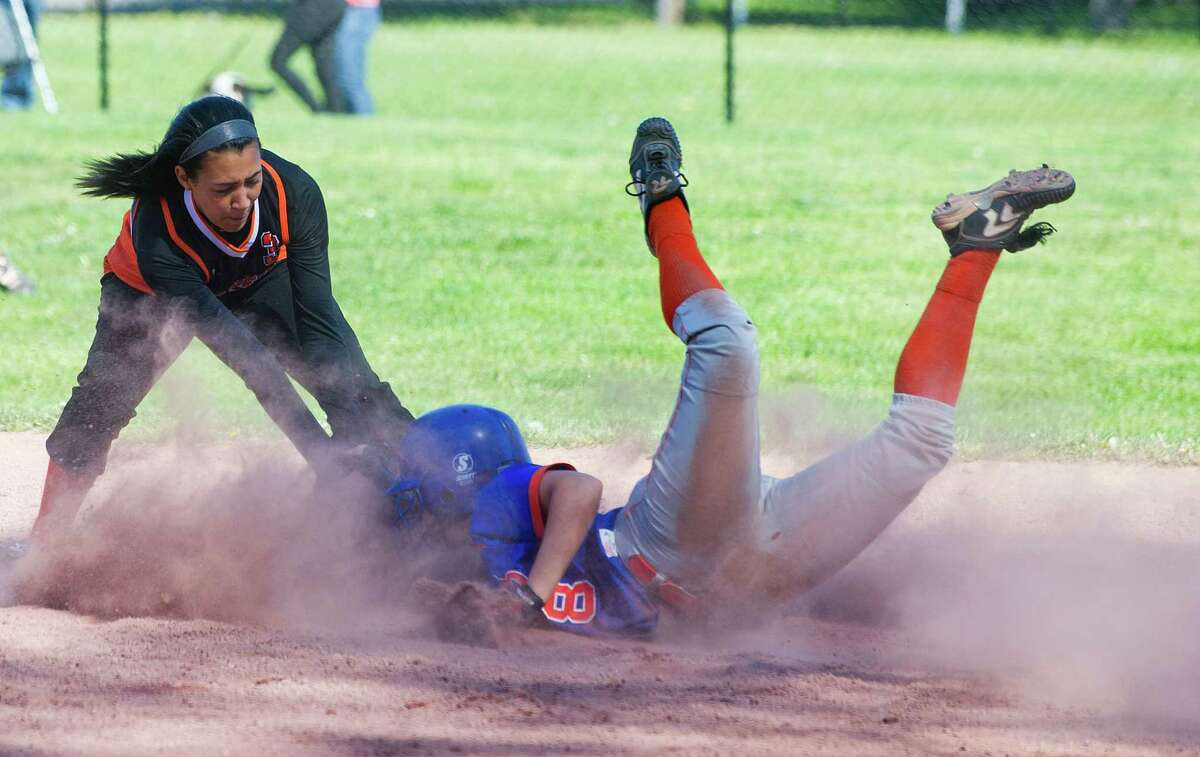 Danbury's Whitney Dyer is safe at second base as Stamford's Brianna Arias reaches to tag during Friday's softball game at Stamford High School on May 3, 2013.