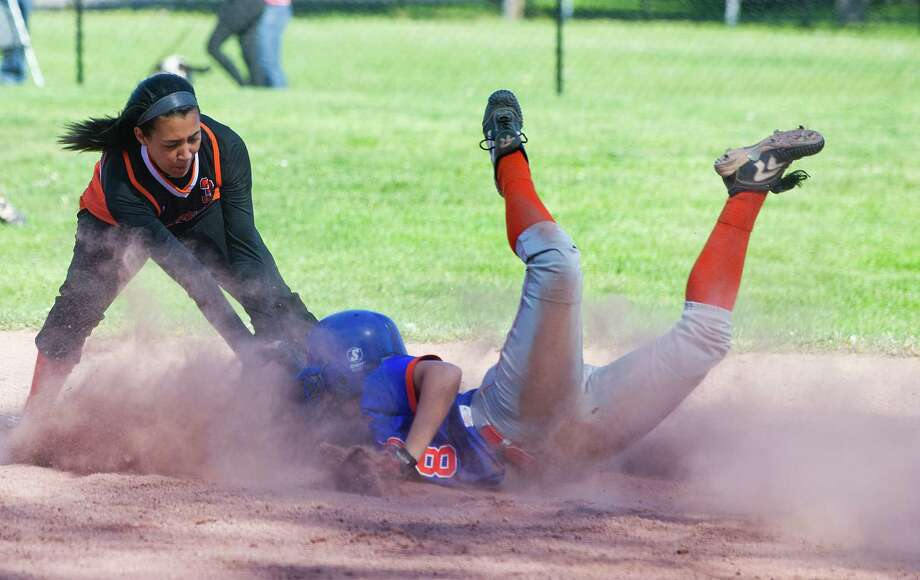 Danbury's Whitney Dyer is safe at second base as Stamford's Brianna Arias reaches to tag during Friday's softball game at Stamford High School on May 3, 2013. Photo: Lindsay Perry / Stamford Advocate