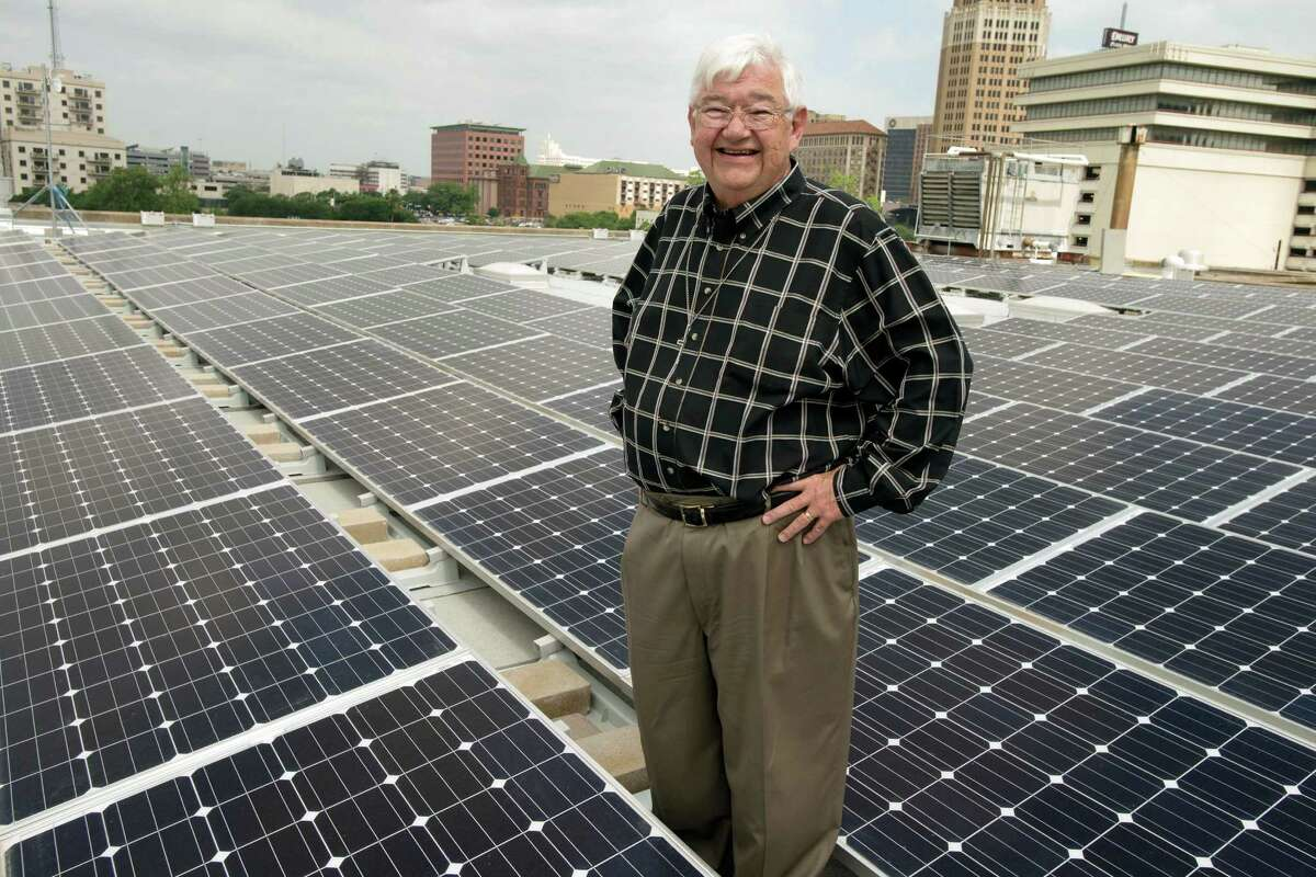 Pastor Skip Courter stands amidst a new solar panel array, Wednesday, May 1, 2013, on the roof of St. John's Lutheran Church in Downtown San Antonio. The array, which consists of 240 solar panels, is capable of producing up to 60 kilowatt-hours of electricity per day. (Darren Abate/For the Express-News)