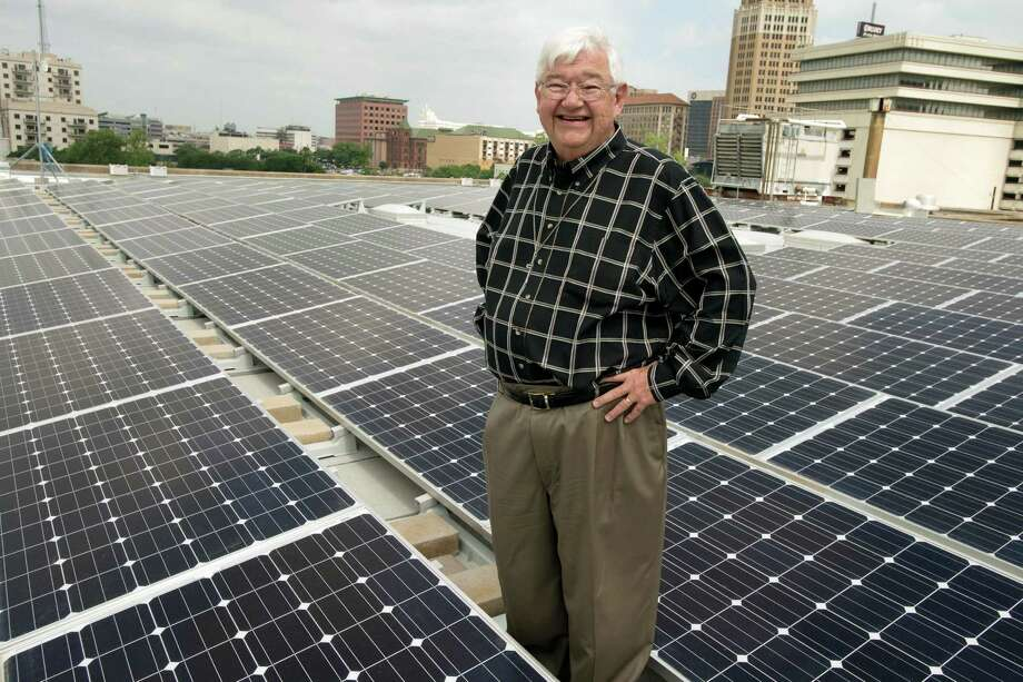 Pastor Skip Courter stands amidst a new solar panel array, Wednesday, May 1, 2013, on the roof of St. John's Lutheran Church in Downtown San Antonio. The array, which consists of 240 solar panels, is capable of producing up to 60 kilowatt-hours of electricity per day. (Darren Abate/For the Express-News) Photo: Photo By Darren Abate/Express-News