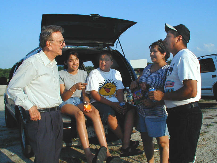John Santikos (owner), Emily Ochoa, Blas Ochoa, Teresa Ochoa and Robert Ochoa (daughters, mom, dad) were at the Mission Drive-In on May 25, 2001, for the reopening of the drive-in. Photo: LELAND A. OUTZ