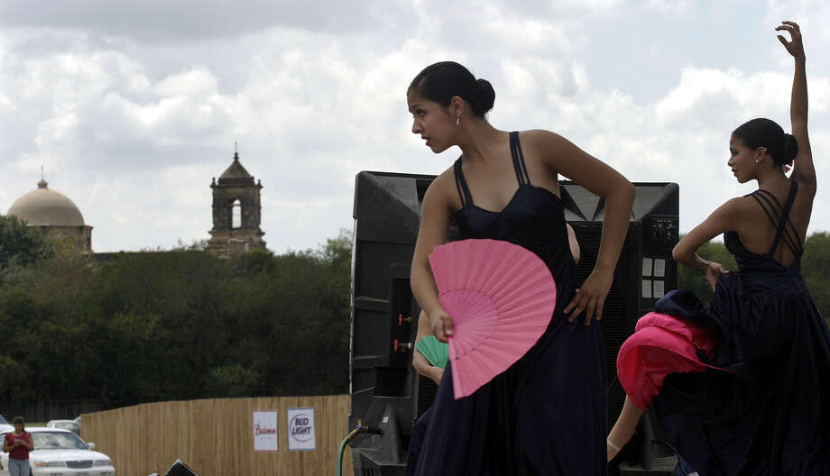 The first concert of the San Antonio Symphony's Around Town series of free concerts took place Sept. 19, 2004, at the Santikos Mission Drive In. Here, Laura Hernandez, left, and Andrea Gonzales, right, perform with the Academy of Dance Arts flamenco dance troupe.  Photo: J. MICHAEL SHORT, SPECIAL TO THE EXPRESS-NEWS / SAN ANTONIO EXPRESS-NEWS