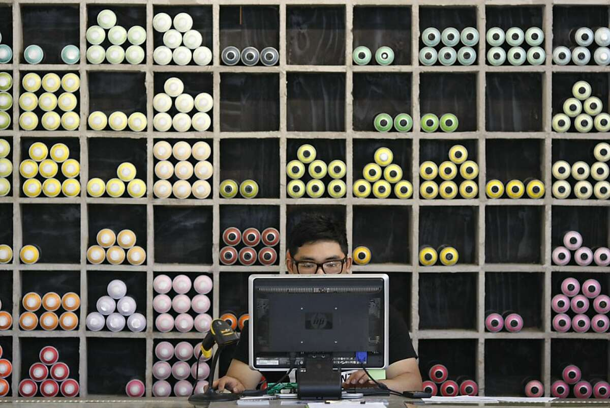 Andrew Baldoza of 1 A.M. Gallery works behind the counter where he sells graffiti supplies in San Francisco Calif. on Friday, May 3.Merchants near Sutter and Larkin say that graffiti and tagging has increased ever since a graffiti supply store opened up in the area.