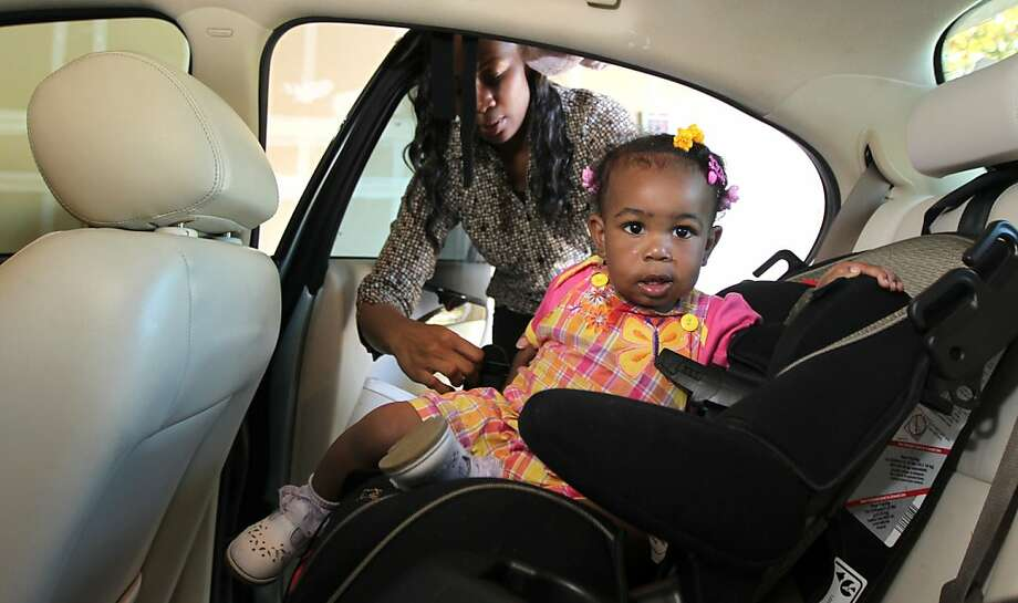 Shanell White takes daughter Imani Rose from her car at their Elk Grove home. White had trouble making payments after using her car for collateral on an 80-percent-interest-rate loan. Photo: Lance Iversen, The Chronicle
