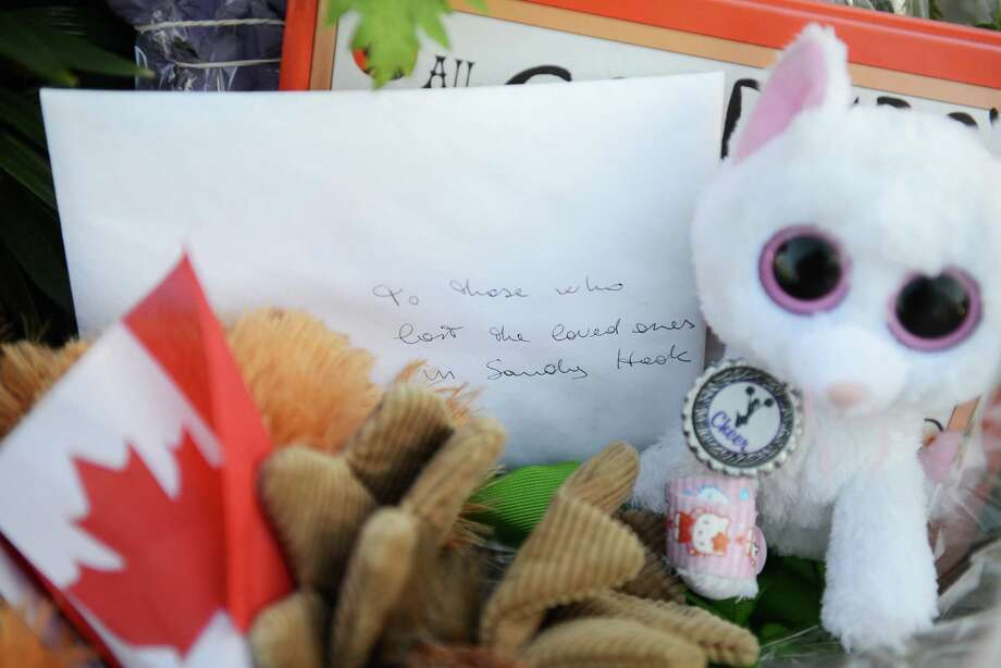 An unopened letter addressed to those who lost loved ones in the Sandy Hook shooting lies next to flowers and other gifts outside Sandy Hook Elementary School in Sandy Hook, Conn. on Friday, May 3, 2013. Photo: Tyler Sizemore / The News-Times