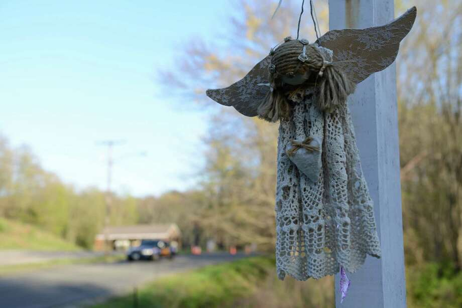 A decorative angel hangs outside Sandy Hook Elementary School in Sandy Hook, Conn. on Friday, May 3, 2013. Photo: Tyler Sizemore / The News-Times