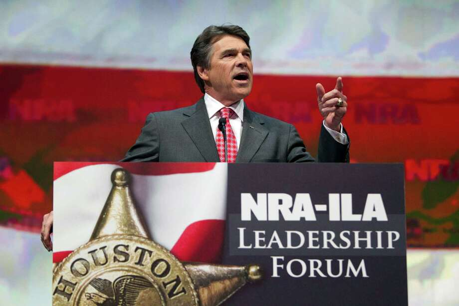 Gov. Rick Perry speaks during the NRA-ILA Leadership Forum at the National Rifle Association's 142 Annual Meetings and Exhibits in the George R. Brown Convention Center Friday, May 3, 2013, in Houston.  The 2013 NRA Annual Meetings and Exhibits runs from Friday, May 3, through Sunday, May 5.  More than 70,000 are expected to attend the event with more than 500 exhibitors represented. The convention will features training and education demos, the Antiques Guns and Gold Showcase, book signings, speakers including Glenn Beck, Ted Nugent and Sarah Palin as well as NRA Youth Day on Sunday Photo: Johnny Hanson, Houston Chronicle / © 2013  Houston Chronicle