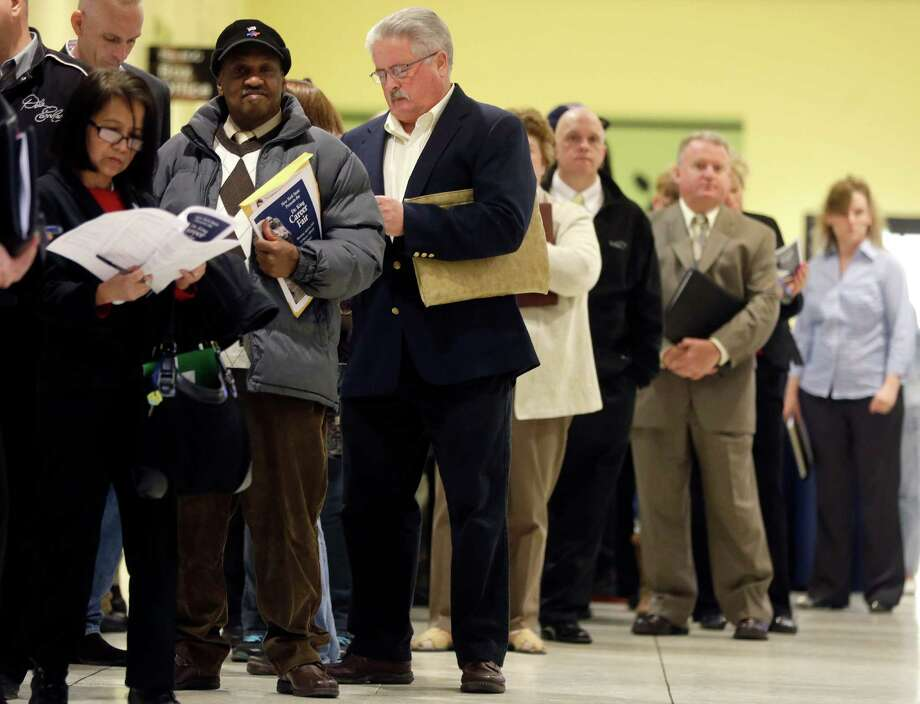 In this Thursday, April 11, 2013, photo, people wait in line before the Dr. King Career Fair at the Empire State Plaza Convention Center in Albany, N.Y.  The government issues the April jobs report on Friday, May 3, 2013. (AP Photo/Mike Groll) Photo: Mike Groll