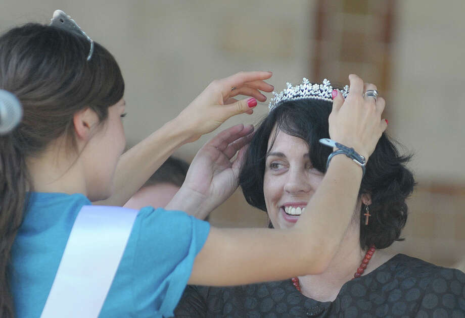 Tulip Queen Emily Finnegan, left, places a crown on Helen Hagen of Rexford after she was announced Mother of the Year at the Tulip Fest on Sunday, May 13, 2012 in Albany, NY.   (Paul Buckowski / Times Union archive) Photo: Paul Buckowski / 00017669A