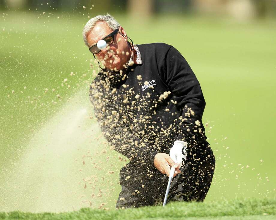 Fuzzy Zoeller blasts from a green-side bunker on No. 1 during the first round of the Insperity Championship, Friday, May 3, 2013 at The Woodlands Country Club Tournament Course in The Woodlands, TX. (Photo: Eric Christian Smith/For the Houston Chronicle) Photo: Eric Christian Smith, For The Chronicle