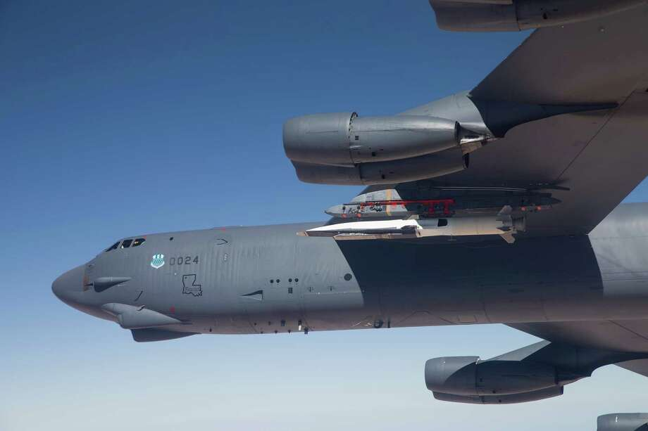 In this Wednesday, May 1, 2013 photo released by the U.S. Air Force, the X-51A Waverider, carried under the wing of a B-52H Stratofortress bomber,  prepares to launch for its fourth and final flight over the Pacific Ocean. The X-51A, an experimental, unmanned aircraft developed for the U.S. Air Force, went hypersonic during a test off the Southern California coast, traveling at more than 3,000 mph, the Air Force said Friday. The Air Force has spent $300 million studying scramjet technology that it hopes can be used to deliver strikes around the globe within minutes. (AP Photo/U.S. Air Force, Bobbi Zapka) Photo: Bobbi Zapka
