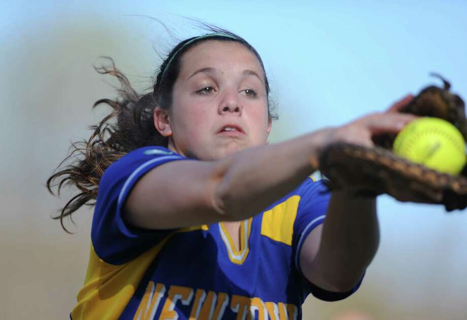 Newtown's Danielle Shine catches a foul ball during undefeated Masuk's 6-0 softball victory over Newtown at Masuk High School in Monroe, Conn. on Friday, May 3, 2013. Photo: Tyler Sizemore / The News-Times