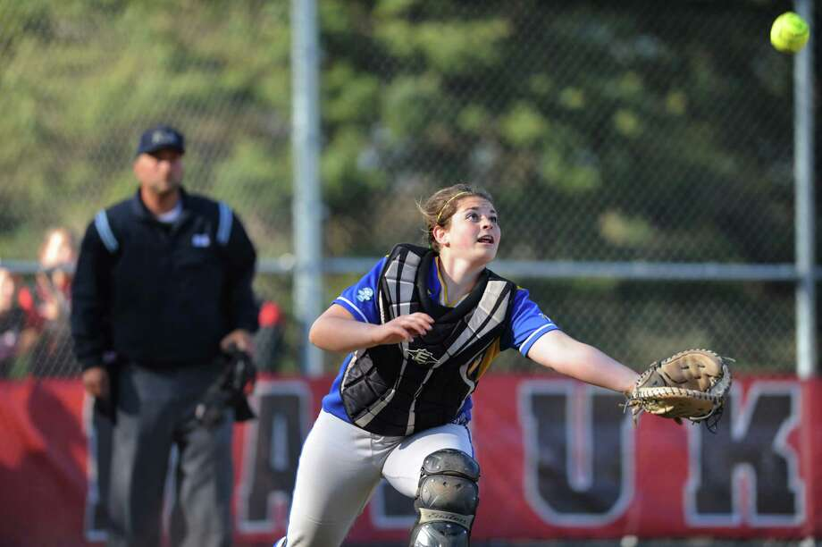 Newtown catcher Emily Woznick attempts to catch a pop up during undefeated Masuk's 6-0 softball victory over Newtown at Masuk High School in Monroe, Conn. on Friday, May 3, 2013. Photo: Tyler Sizemore / The News-Times