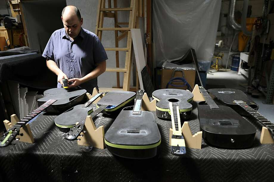 Founder Joe Luttwak checks on an assortment of guitars in varying states of production in his shop on Folsom St.  Blackbird Guitars makes custom carbon fiber guitars at their shop Mission District of San Francisco, CA, Friday May 3rd, 2013. Photo: Michael Short, Special To The Chronicle