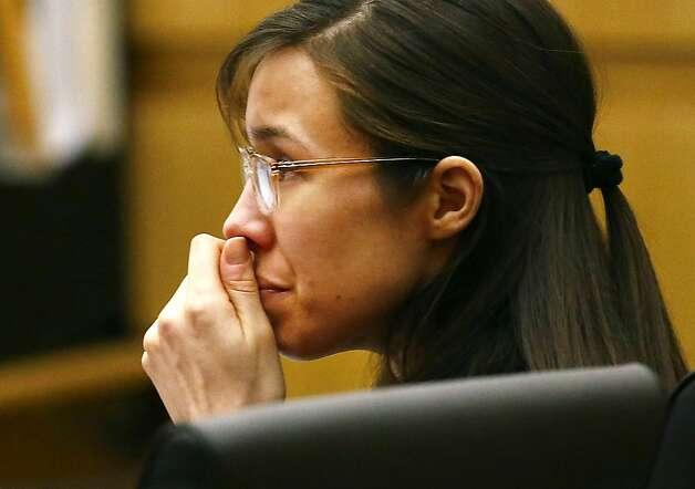 Defendant Jodi Arias listens to defense attorney Kirk Nurmi make his ...