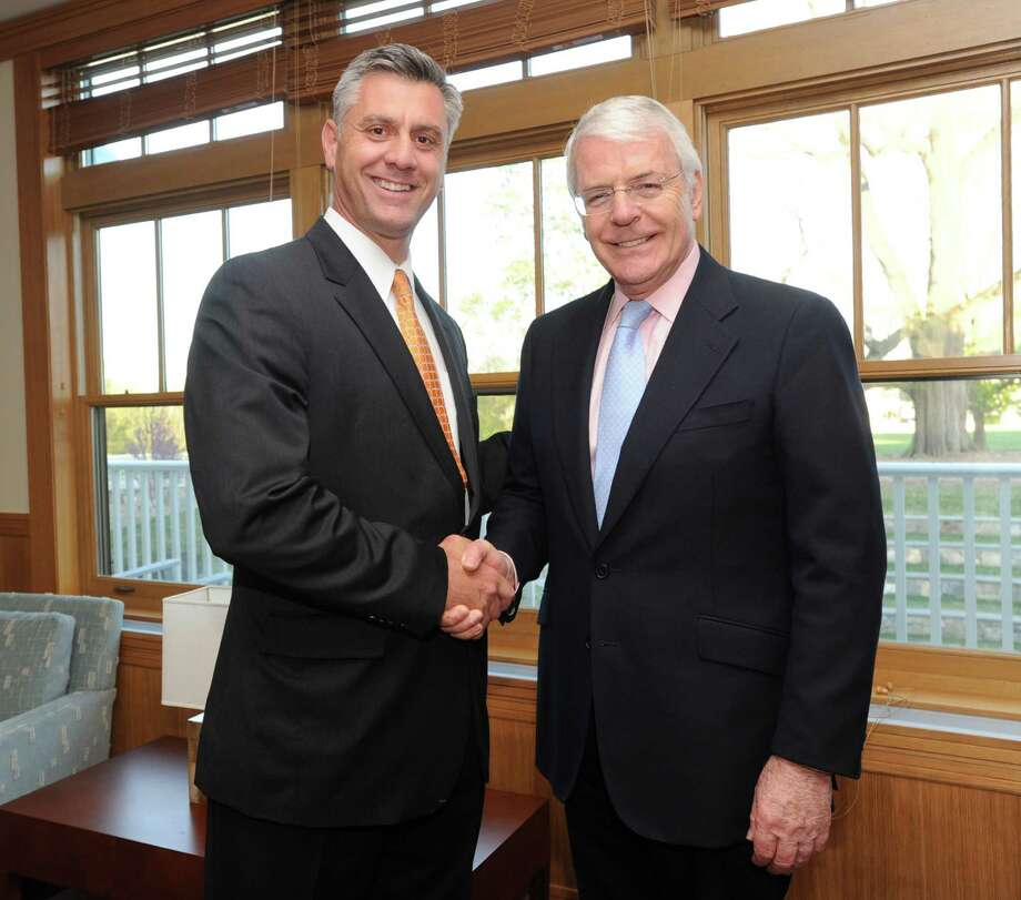 """At left, Adam Rohdie, headmaster of Greenwich Country Day School, shakes hands with the former Prime Minister of Great Britain, Sir John Major, during the Greenwich Chapter of Room to Read's benefit at Greenwich Country Day School, Friday night, May 3, 2013. The theme of the evening was """"Empowering Girls through Education."""" Photo: Bob Luckey / Greenwich Time"""