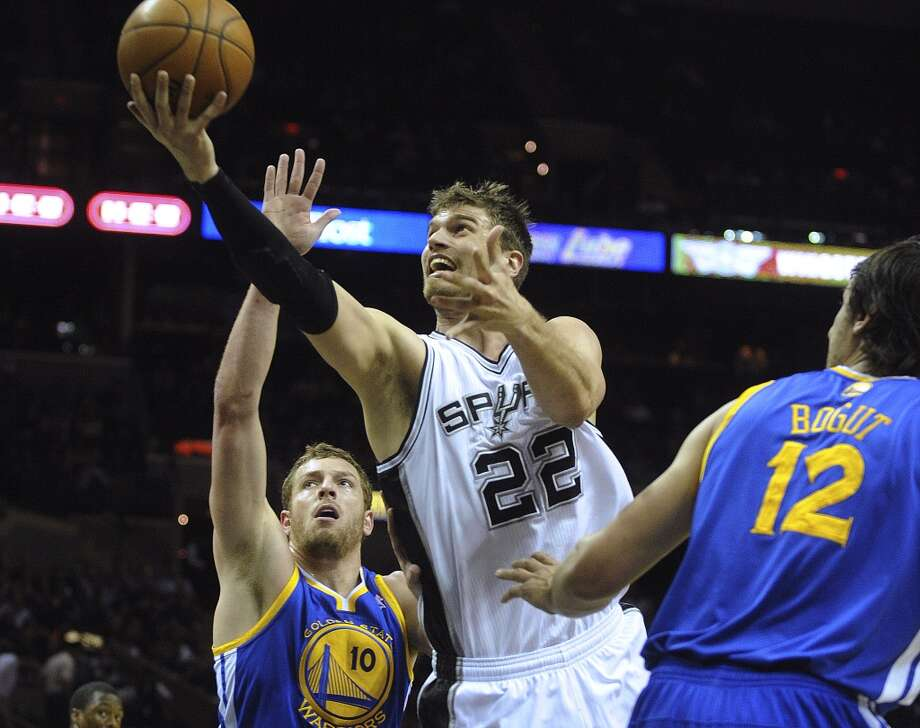 Tiago Splitter of the Spurs (22) scores on this layup as David Lee (10) and Andrew Bogut (12) of the Golden State Warriors defend during NBA action at the AT&T Center on Wednesday, March 20, 2013.