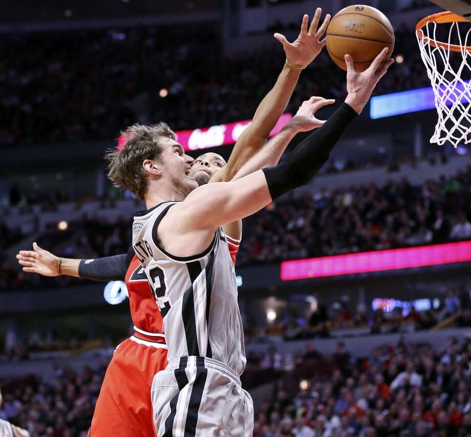 San Antonio Spurs' Tiago Splitter shoots around Chicago Bulls' Taj Gibson during second half action Monday Feb. 11, 2013 at the United Center in Chicago, IL. The Spurs won 103-89.