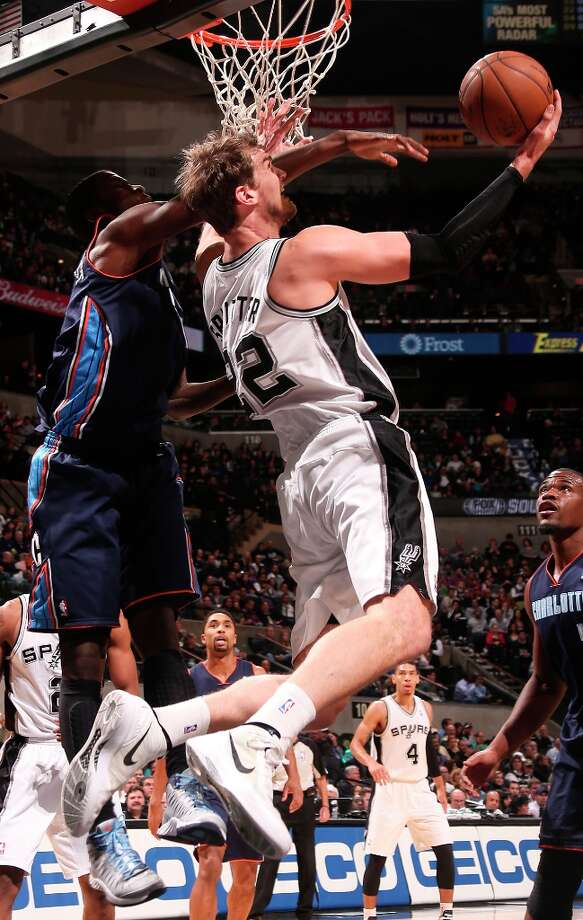 San Antonio Spurs' Tiago Splitter gets pressure from Charlotte Bobcats' Michael Kidd-Gilchrist during the first half at the AT&T Center, Wednesday, Jan. 30, 2013. Photo: Jerry Lara, San Antonio Express-News / © 2013 San Antonio Express-News