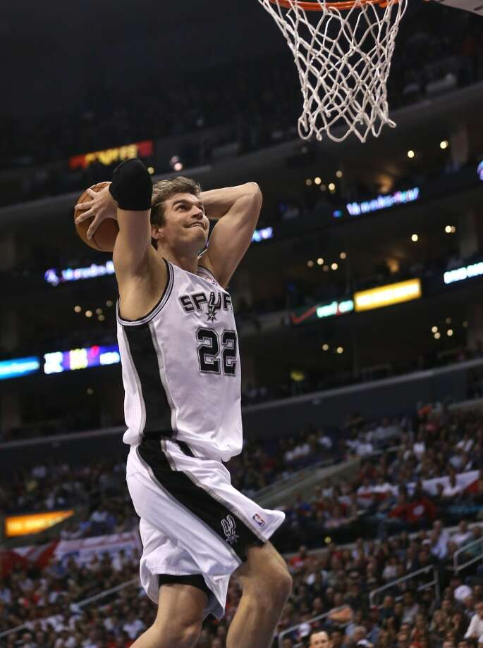 Tiago Splitter (22) of the Spurs dunks against the Clippers at Staples Center on Nov. 7, 2012 in Los Angeles.  The Clippers won 106-84.