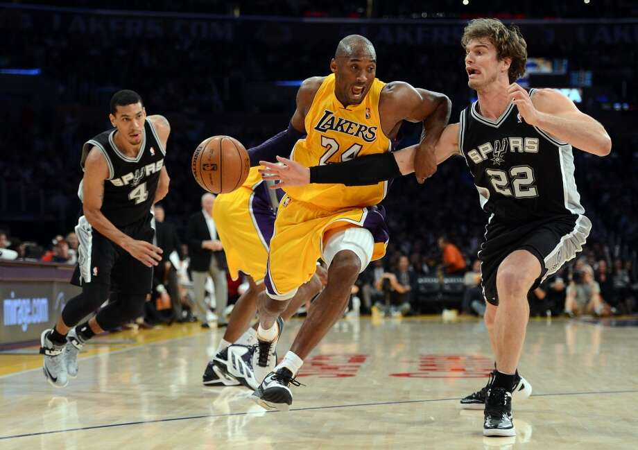Kobe Bryant (24) of the Lakers drives on Tiago Splitter (22) of the Spurs during an 84-82 Spurs win at Staples Center on Nov. 13, 2012 in Los Angeles.