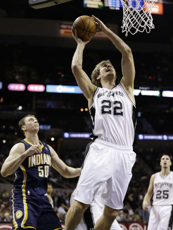 San Antonio Spurs' Tiago Splitter (22) shoots as Indiana Pacers' Tyler Hansbrough (50) looks of during the fourth quarter, Monday, Nov. 5, 2012, in San Antonio.