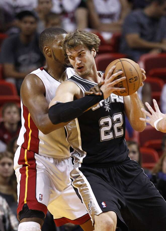 Miami Heat's Dexter Pittman (45) and San Antonio Spurs' Tiago Splitter (22) during the first half of a NBA basketball game in Miami, Saturday,Oct. 20, 2012.