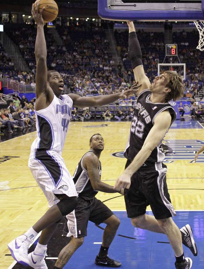 The Magic's Andrew Nicholson (44) makes a shot over the Spurs' Tiago Splitter (22) during the second half of an NBA preseason basketball game, Sunday, Oct. 21, 2012, in Orlando, Fla. Orlando won 104-100.
