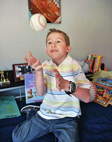 Six-year-old Callahan Urkuhart in his bedroom at his Troy home Tuesday April 30, 2013.  Callahan will be recognized as this year's Heart Hero at the Heart Walk. He had a congenital heart defect and underwent surgery at 9 days old. He's healthy, active and athletic now.  (John Carl D'Annibale / Times Union) Photo: John Carl D'Annibale / 10022147A