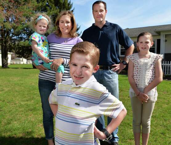 Six-year-old Callahan Urkuhart, center, and his family,from left, little sister Breigh, 3, mom Maggie, dad Bill and big sister Olivia, 8, outside their Troy home Tuesday April 30, 2013.  Callahan will be recognized as this year's Heart Hero at the Heart Walk. He had a congenital heart defect and underwent surgery at 9 days old. He's healthy, active and athletic now.  (John Carl D'Annibale / Times Union) Photo: John Carl D'Annibale / 10022147A
