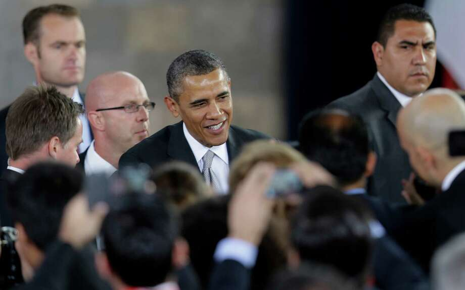 President Barack Obama greets people as he arrives to speak at the Anthropology Museum in Mexico City, Mexico, Friday, May 3, 2013. (AP Photo/Dario Lopez-Mills) Photo: Dario Lopez-Mills