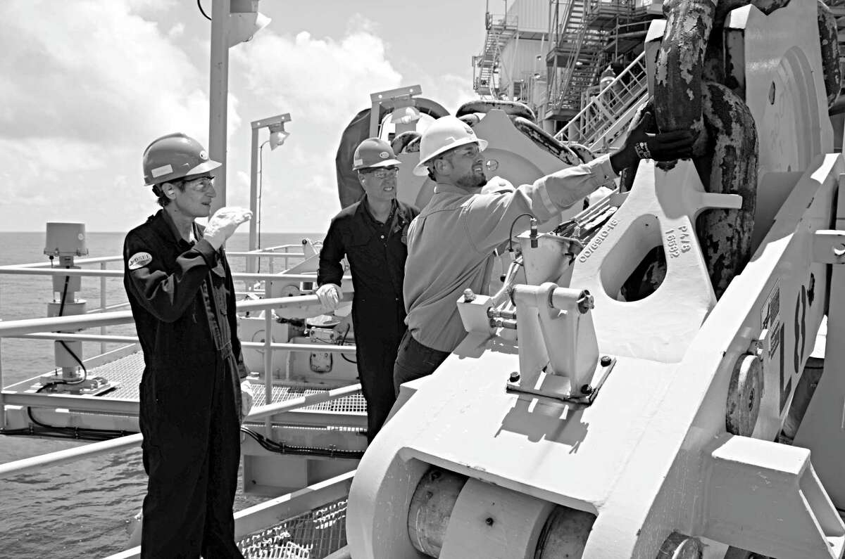 Secretary of the Interior Sally Jewell examines the mooring system on Chevron's Blind Faith platform.