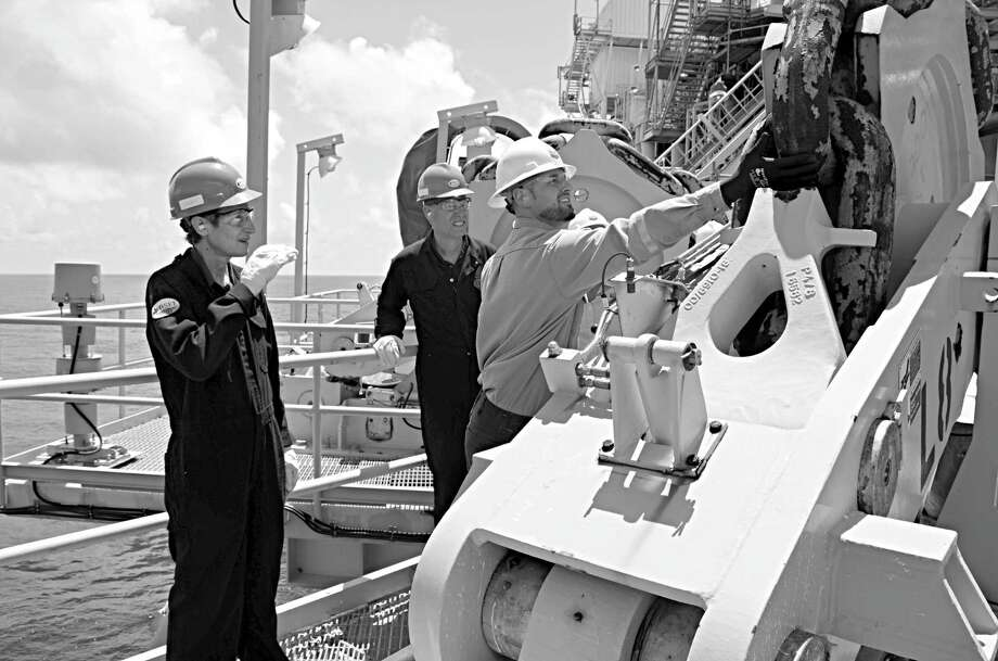 Secretary of the Interior Sally Jewell examines the mooring system on Chevron's Blind Faith platform. Photo: Jennifer A. Dlouhy / Houston Chronicle
